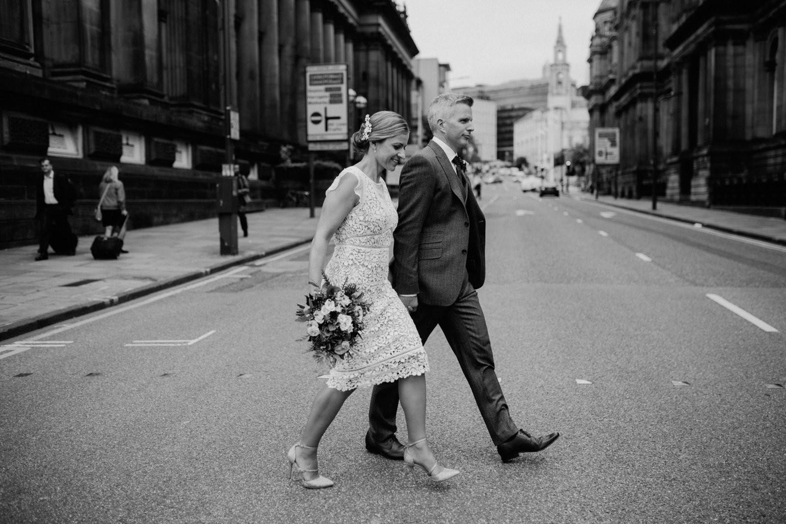 Bride and groom outside town hall, Leeds. Modern alternative wed